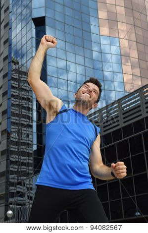 Attractive Sport Man Doing Victory And Winner Sign With His Arms After Running Training In Urban Bus