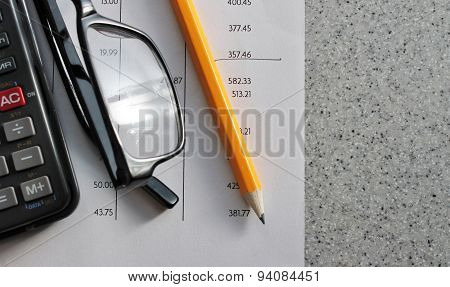 Bank Statement With Pencil Glasses And Calculator