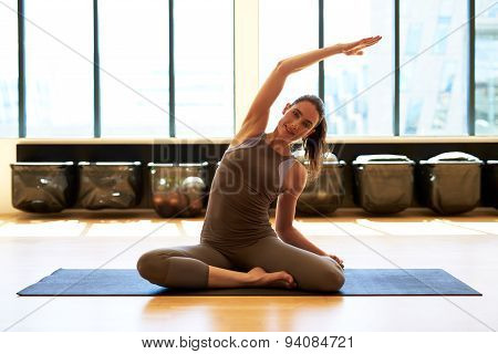 Smiling Woman Is Exercising