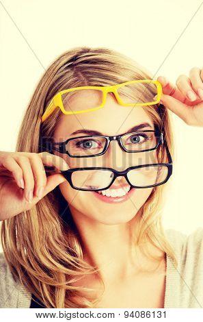 Young woman checking new  eyeglasses