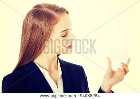 Beautiful smiling businesswoman with business card.