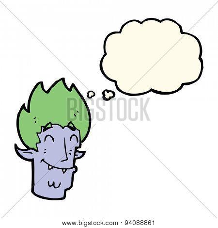 cartoon happy vampire head with thought bubble