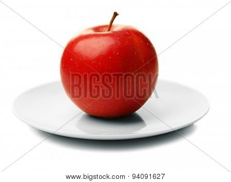Apple on saucer isolated on white