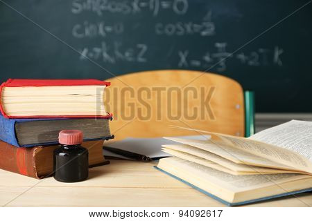 Teachers workplace  on blackboard background