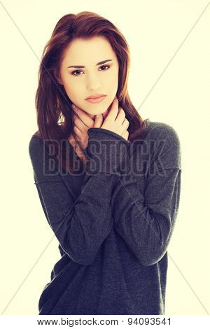 Charming young woman with terrible throat pain.