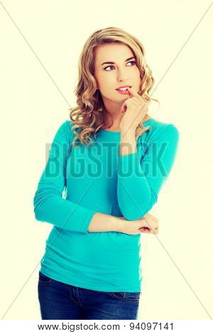 Young woman thinking about some concept