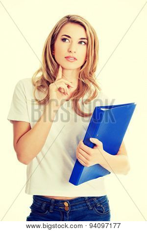 Young student woman thinking about some concept