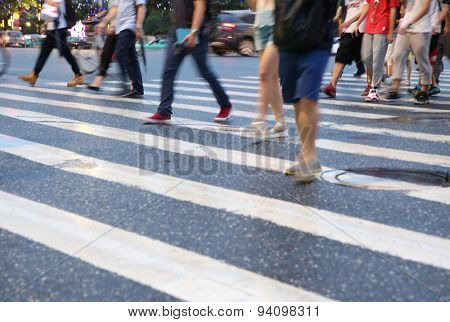 Pedestrians crowd in city street abstract blur