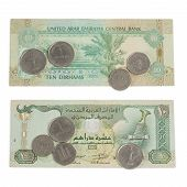 picture of dirhams  - Ten Dirham Note and Coins Currency of the United Arab Emirates on wooden table - JPG