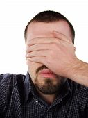 pic of male face  - young caucasian male covering his eyes with his hand - JPG