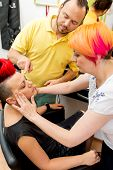 foto of makeup artist  - Makeup teacher helping students training to become makeup artist  - JPG