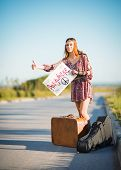 pic of hippy  - Portrait of a lovely young hippie girl hitchhiking on the road - JPG