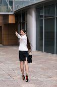 foto of girl walking away  - Beautiful businesswoman walk away and show thumb up - JPG
