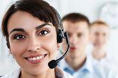 foto of helpdesk  - Three call center service operators at work - JPG