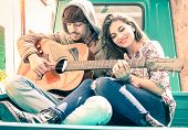 picture of ape-man  - Romantic couple of lovers playing guitar on old fashioned mini car  - JPG