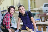 picture of carpentry  - Portrait of young apprentices in carpentry school - JPG