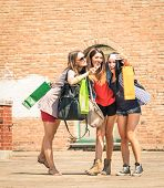 picture of  friends forever  - Group of happy best friends with shopping bags taking a selfie in the city center  - JPG