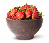 stock photo of ceramic bowl  - Ripe juicy strawberries in a ceramic bowl isolated on white background - JPG