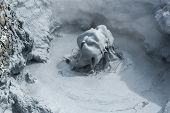 stock photo of boil  - Sculptures of boiling mud in Hverir geothermal area - JPG
