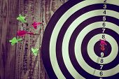 pic of count down  - Dartboard on wood wall  - JPG
