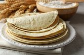 image of whole-wheat  - Stack of homemade whole wheat flour tortilla on napkin - JPG