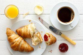 stock photo of continental food  - Coffee orange juice and croissant breakfast - JPG