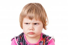 image of frown  - Cute small Caucasian blond baby girl angry frowns studio portrait isolated on white background - JPG