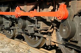 foto of train-wheel  - Wheels of and old vintage steam railway engine train on a railway track - JPG