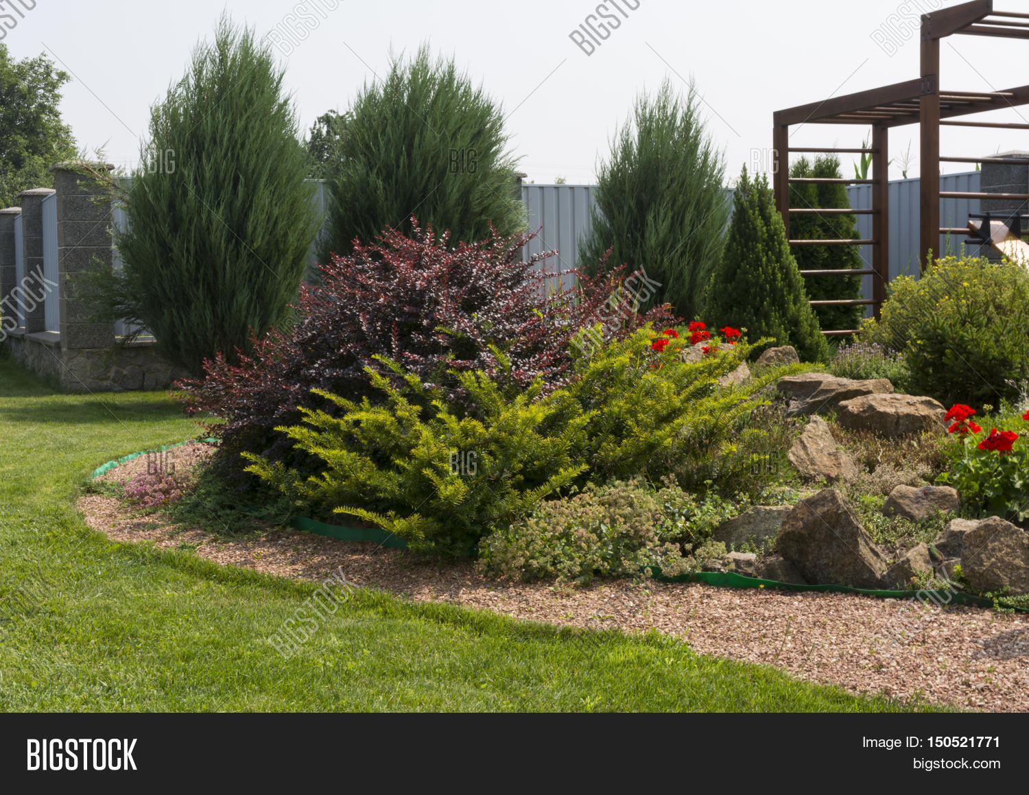 Flower bed stones flowers green image photo bigstock for Green plants for flower beds