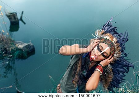 Native American Girl In National Clothes In Front Of Lake