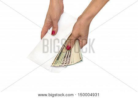 Human hand holding envelope with dollar bills