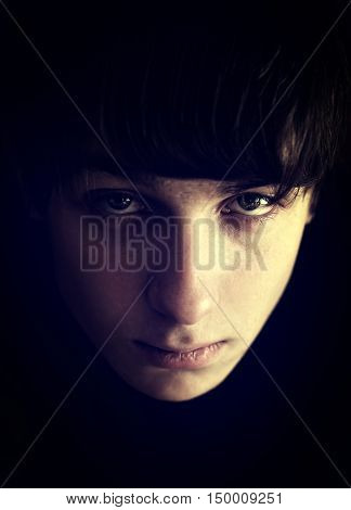 Toned Photo of Sad Teenager Portrait closeup with Focus on an Eye