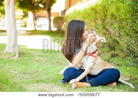Showing Some Love To Her Dog