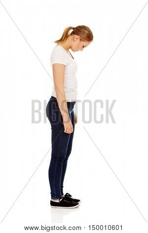 Side view of young sad woman