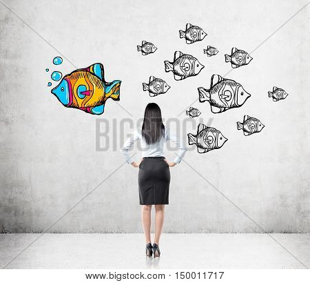 Rear view of woman with black hair looking at fish sketches on concrete wall. All fish are black and white. One is colored and swimming in different direction. Concept of original way of thought