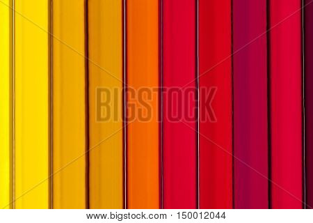Background of parallel colorful pencils abstractclose up