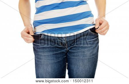 Teenage woman taking out empty pockets