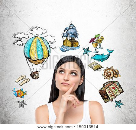 Close up of girl in white tank top against concrete wall with ancient transportation devices and travel icons. Concept of time travelling
