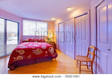 Purple Bedroom With Pink Red Bed And Flowers