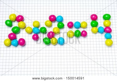 Two plus two from candy number  on a sheet of notebook
