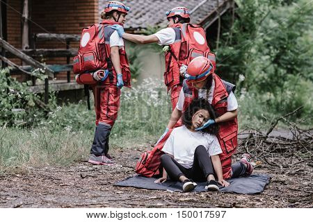 Paramedics rescuing disaster victim, toned image, horizontal