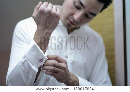 Groom Is Wearing Cuff-links Indoors. Male Portrait Of Handsome Guy. Beautiful Model Boy In Colorful
