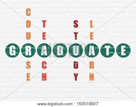 Education concept: Painted green word Graduate in solving Crossword Puzzle