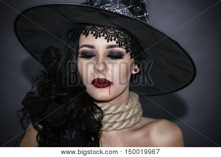 Portrait of a witch with a rope throat. halloween concept