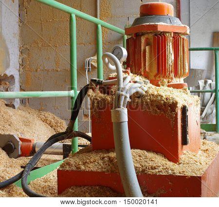 Boiler room hydraulic system supplying wood sawdust.