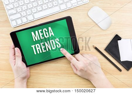 Finger Click Screen With Mega Trends Word With Keyboard And Notebook On Wooden Table,digital Busines