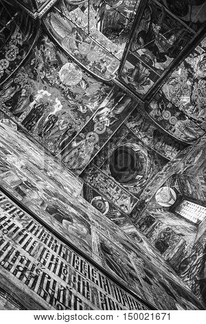 YAROSLAVL, RUSSIA - SEPTEMBER 5, 2015: Interiors of Church of Elijah the Prophet - beautiful religious paintings at ceiling made by Kostroma masters. It is a famous landmark. Black and white