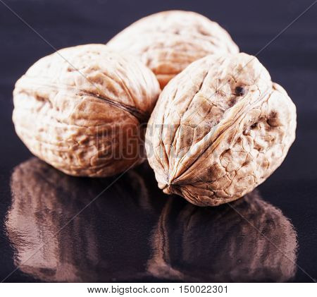 Walnuts Over Black Reflecting Background
