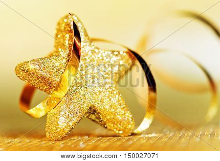 A golden Christmas star with a ribbon
