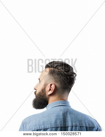 Portrait of a bearded man in a denim shirt isolated on a white background. There is a spase for your text.
